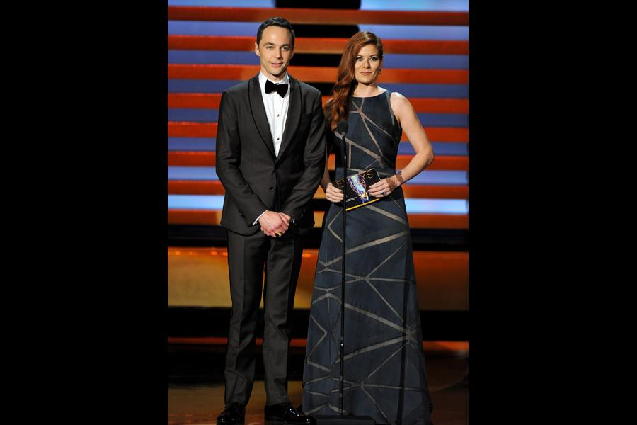 Jim Parsons (l) of The Big Bang Theory and Debra Messing present an award at the 66th Emmy Awards.