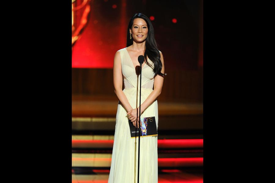 Lucy Liu of Elementary presents an award at the 66th Emmys.