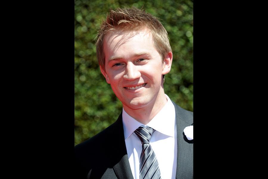 Jason Dolley arrives for the 2014 Primetime Creative Arts Emmys.