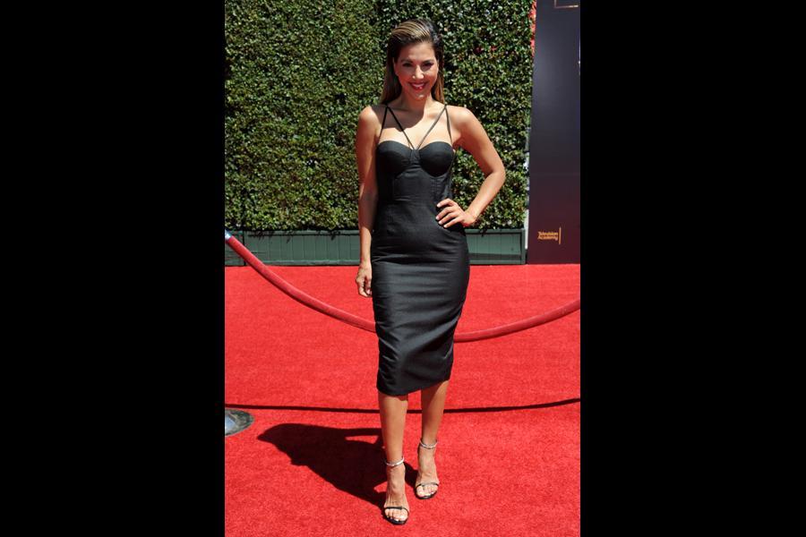 Liz Hernandez arrives for the 2014 Primetime Creative Arts Emmys.