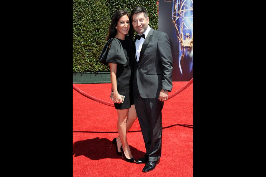 Suzann Levine, left, and James S. Levine arrive for the 2014 Primetime Creative Arts Emmys.