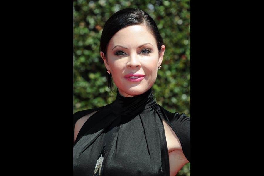 Christa Campbell arrives for the 2014 Primetime Creative Arts Emmys.