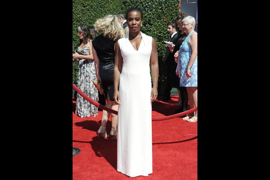 Uzo Aduba arrives for the 2014 Primetime Creative Arts Emmys.