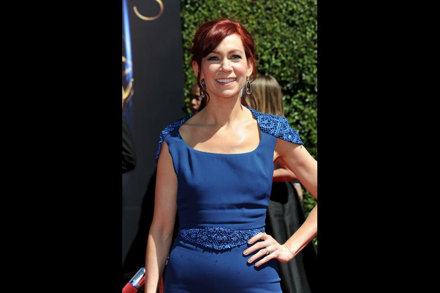 Carrie Preston arrives for the 2014 Primetime Creative Arts Emmys.