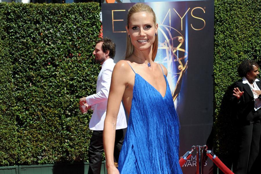 Heidi Klum arrives for the 2014 Primetime Creative Arts Emmys.