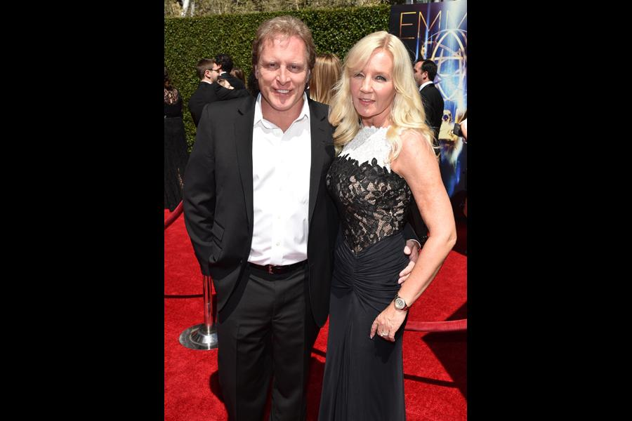 Sig Hansen and June Hansen arrive for the 2014 Primetime Creative Arts Emmys.
