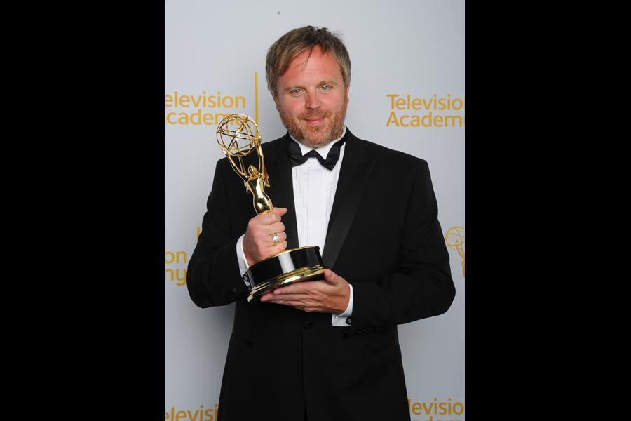 Sherlock editor Yan Miles celebrates his win at the 2014 Primetime Creative Arts Emmys.