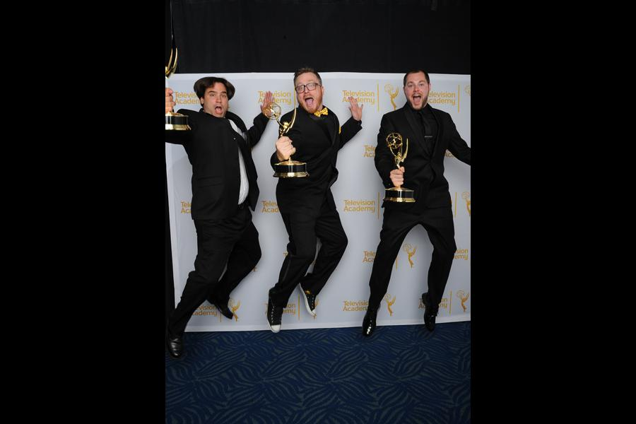 Deadliest Catch editors Rob Butler (l), Josh Earl (c) and Art O'Leary (r) celebrate their win at the 2014 Primetime Creative Arts Emmys.