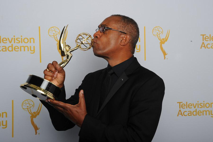 Joe Morton of Scandal celebrates his win at the 2014 Primetime Creative Arts Emmys.