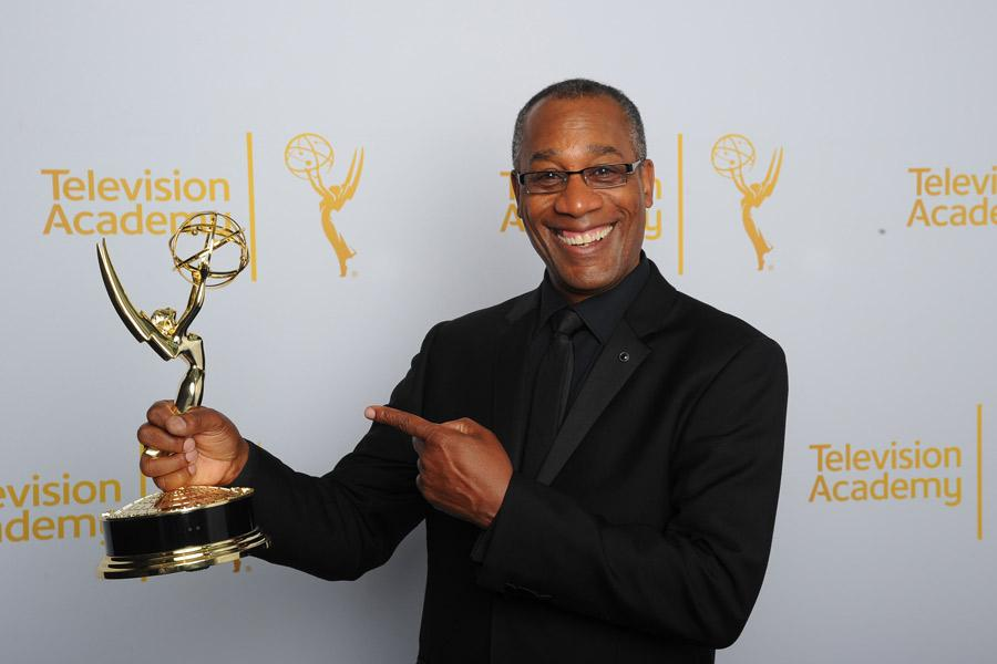 Joe Morton of Scandal celebrates at the 2014 Primetime Creative Arts Emmys.