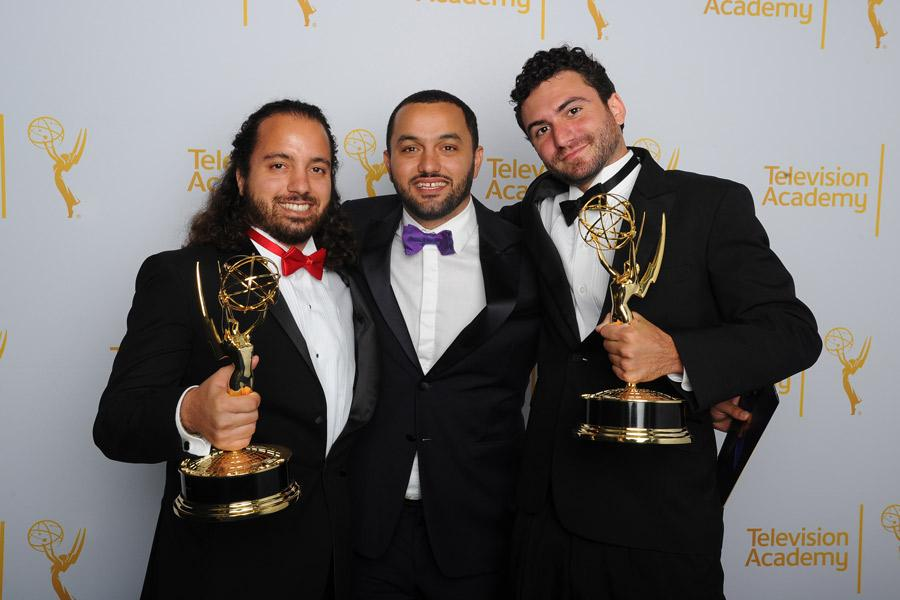 The Square editing team members Mohamed El Manasterly (l), Pedro Kos (c) and Christopher de la Torre (r) celebrate their win for Outstanding Picture Editing for Nonfiction Programming at the 2014 Primetime Creative Arts Emmys.