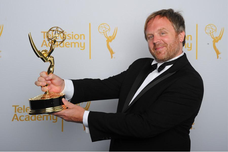 Yan Miles celebrates at the 2014 Primetime Creative Arts Emmys.