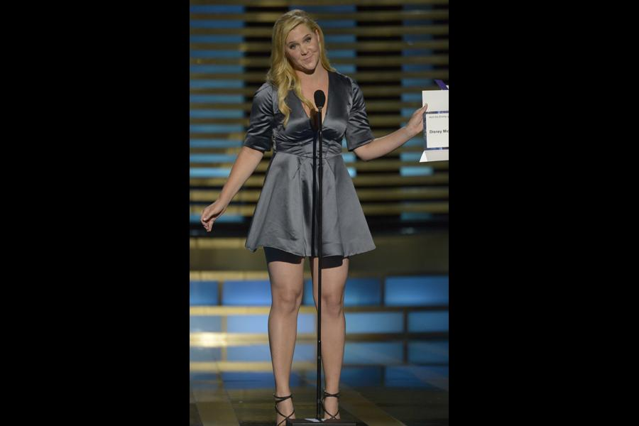 Amy Schumer presents an award at the 2014 Primetime Creative Arts Emmys.