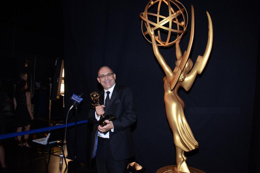 The Big Bang Theory editor Peter Chakos celebrates his win at the 2014 Primetime Creative Arts Emmys.