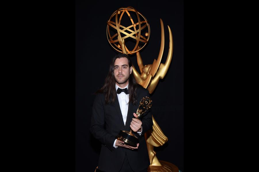 Sean Szeles celebrates at the 2014 Primetime Creative Arts Emmys.