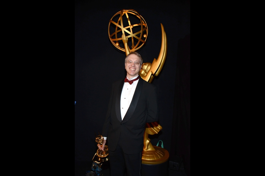 The Daily Show with Jon Stewart editor Eric Davies celebrates his win at the 2014 Primetime Creative Arts Emmys.