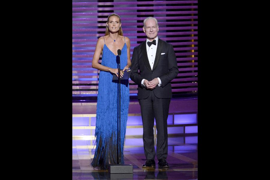 Heidi Klum and Tim Gunn present an award at the 2014 Primetime Creative Arts Emmys.