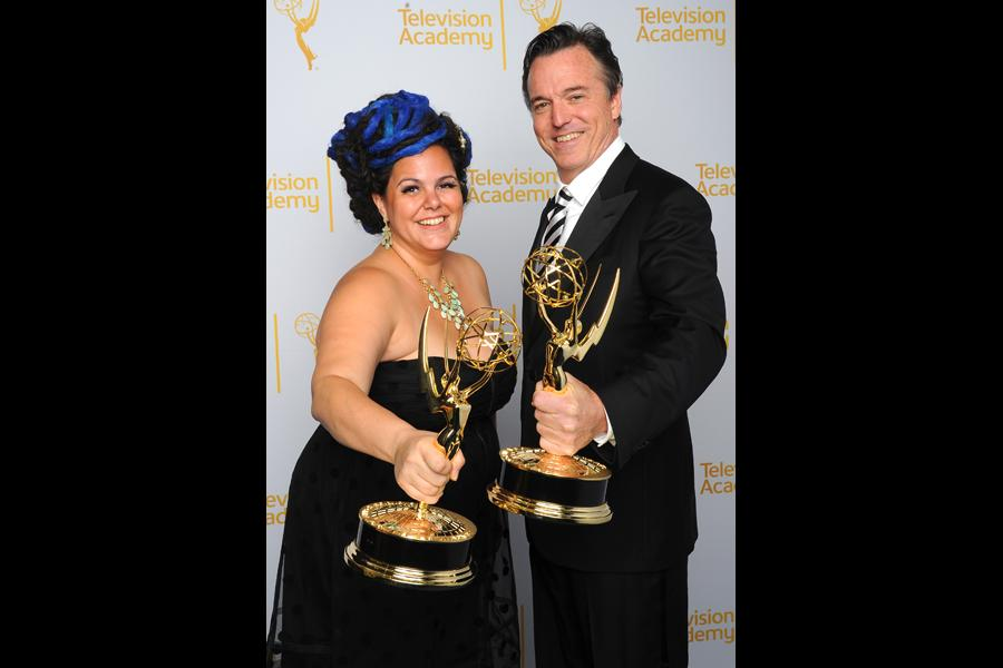 The Oscars art direction team members Gloria Lamb (l) and Derek McLane (r) celebrate their win at the 2014 Primetime Creative Arts Emmys.