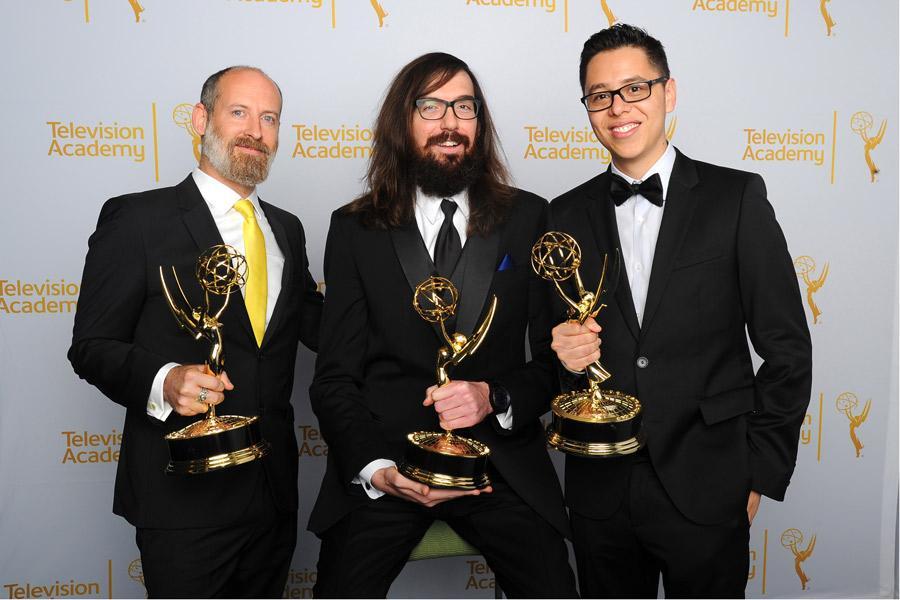 Disney Mickey Mouse writing team members Paul Rudish (l), Derek Dressler (c) and Alonso Ramirez Ramos (r) celebrate their win at the 2014 Primetime Creative Arts Emmys.