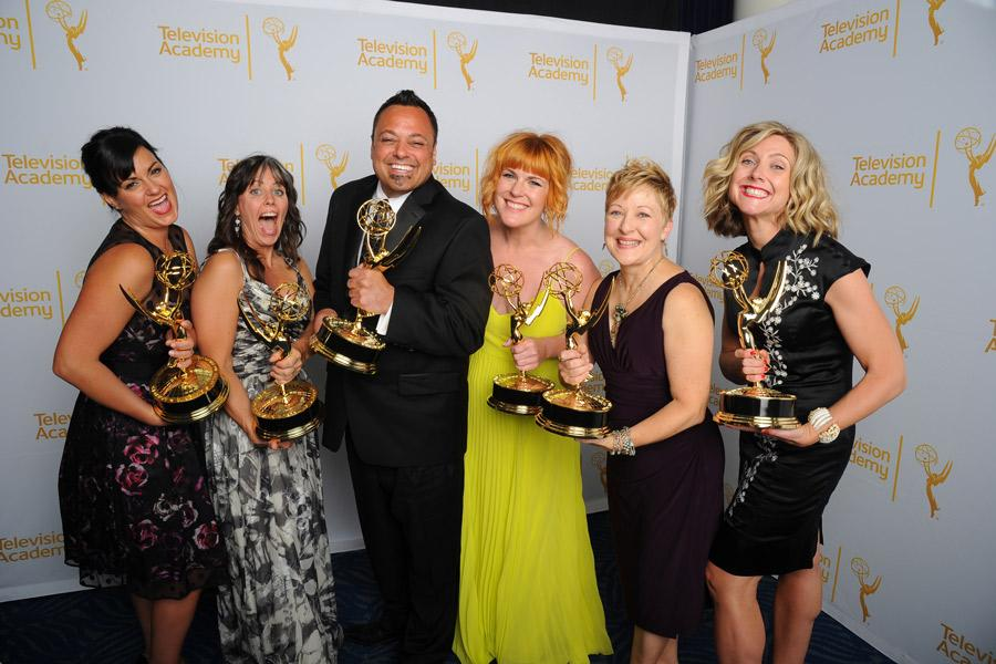 The Saturday Night Live hairstyling team celebrate their win at the 2014 Primetime Creative Arts Emmys.