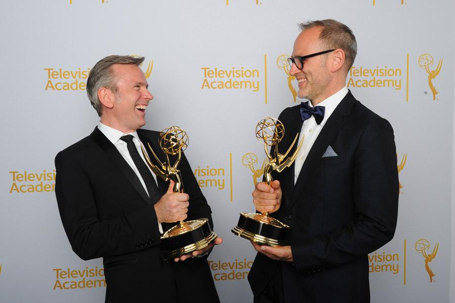 Saturday Night Live costume designers Eric Justian (l) and Tom Broecker (r) celebrate their win at the 2014 Primetime Creative Arts Emmys.