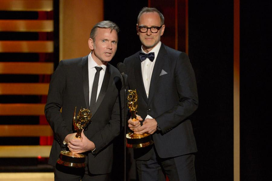 Tom Broecker and Eric Justian accept the award for outstanding costumes on Saturday Night Live.