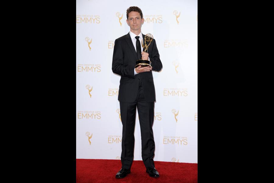 Ian Worrel celebrates at the 2014 Primetime Creative Arts Emmys.