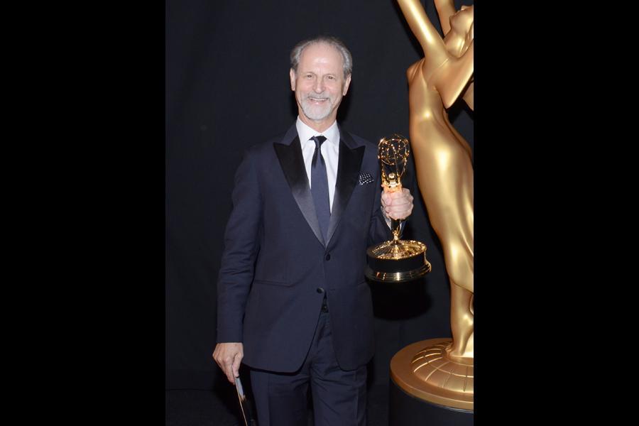 American Masters sound mixer Eddie Kramer celebrates his win at the 2014 Primetime Creative Arts Emmys.
