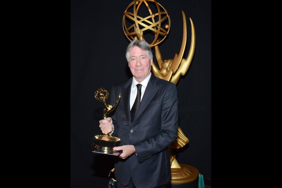 Cosmos: A SpaceTime Odyssey composer Alan Silvestri celebrates his win at the 2014 Primetime Creative Arts Emmys.
