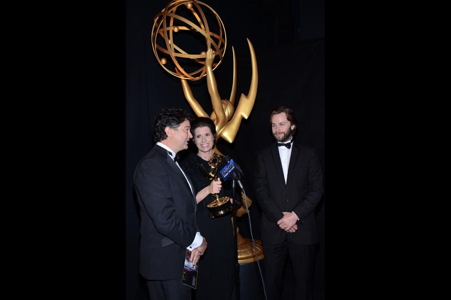 Game of Thrones art direction team members Paul Ghirardani (l), Deborah Riley (c) and Rob Cameron (r) celebrate their win at the 2014 Primetime Creative Arts Emmys.