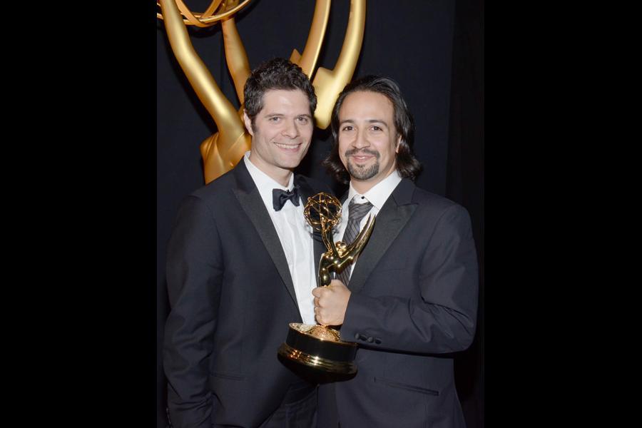 Tom Kitt (l) and Lin-Manuel Miranda (r) celebrate at the 2014 Primetime Creative Arts Emmys.
