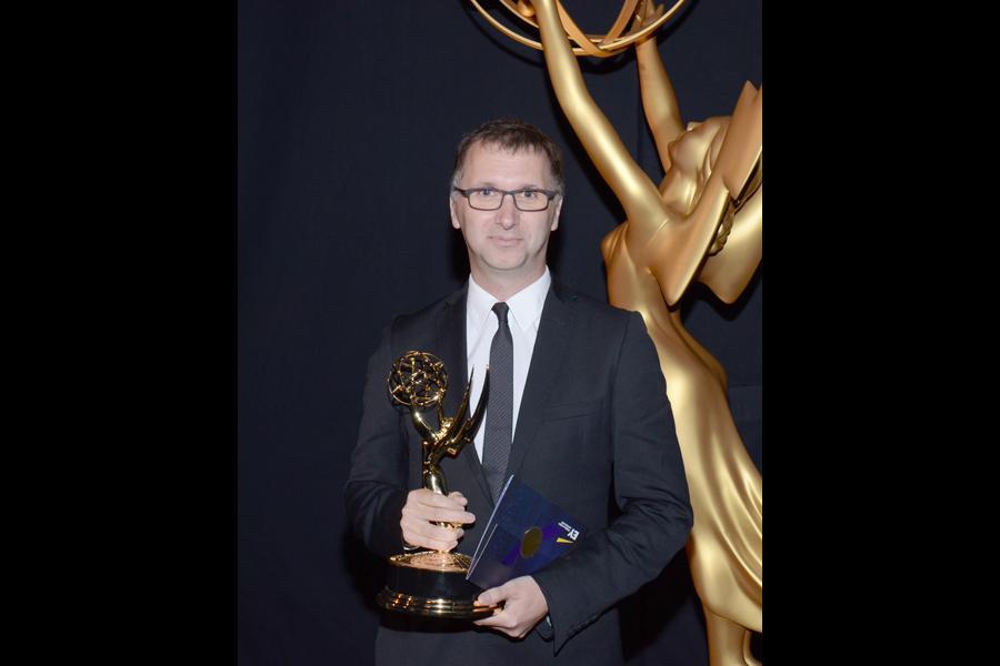 Sherlock composer Michael Price celebrates his win at the 2014 Primetime Creative Arts Emmys.