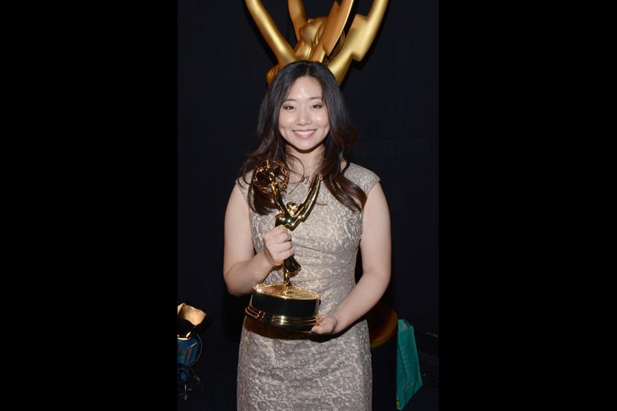 The Powerpuff Girls animator Jasmin Lai celebrates her win at the 2014 Primetime Creative Arts Emmys.