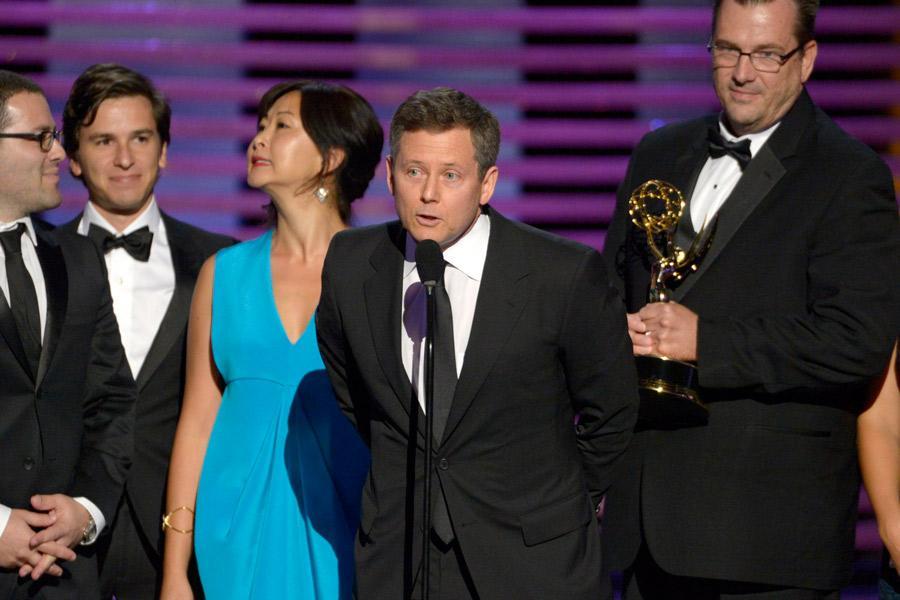 The Shark Tank team accepts an award at the 2014 Primetime Creative Arts Emmys.