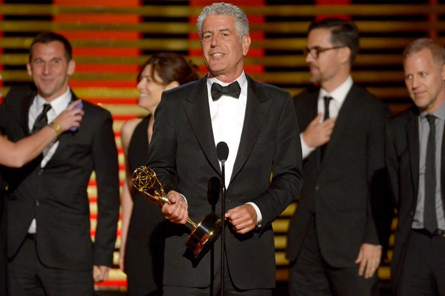 Anthony Bourdain and the team from Anthony Bourdain: Parts Unknown accept an award at the 2014 Primetime Creative Arts Emmys.