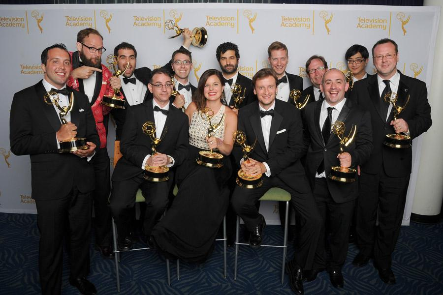 The Colbert Report cast and crew celebrate their win at the 2014 Primetime Creative Arts Emmys.