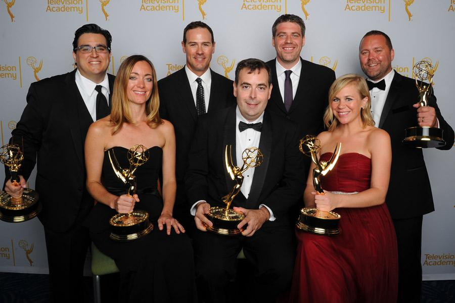 Outstanding Achievement in Interactive Media winners celebrate at the 2014 Primetime Creative Arts Emmys.