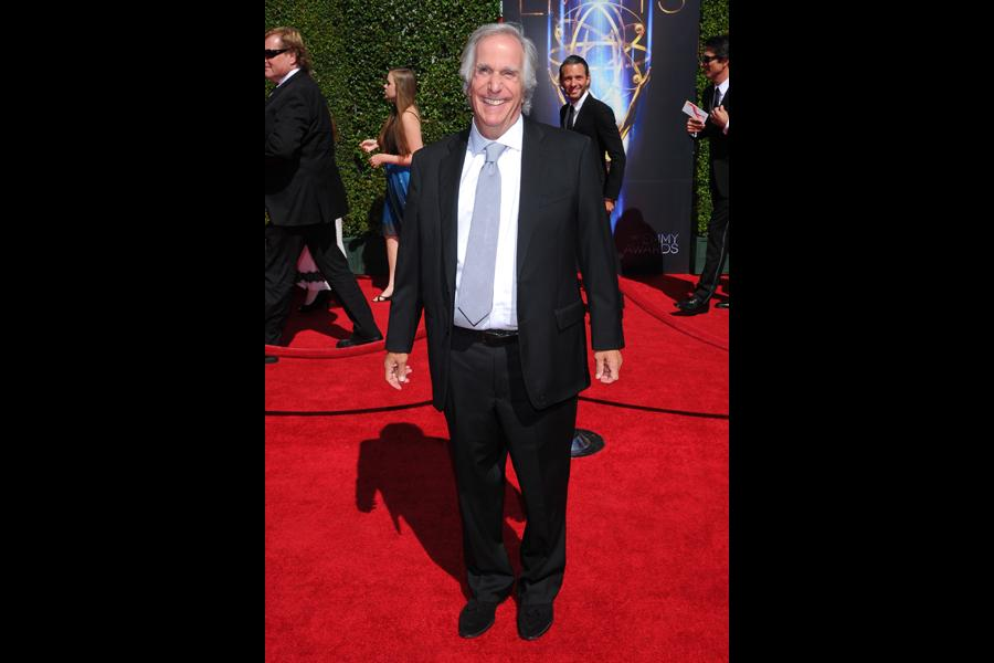 Henry Winkler arrives for the 2014 Primetime Creative Arts Emmys.