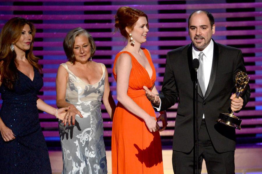Saturday Night Live hairstylists (from left) Daniela Zivkovic, Melanie Demitri, Sarah Egan and Louie Zakarian accept an award at the 2014 Primetime Creative Arts Emmys.