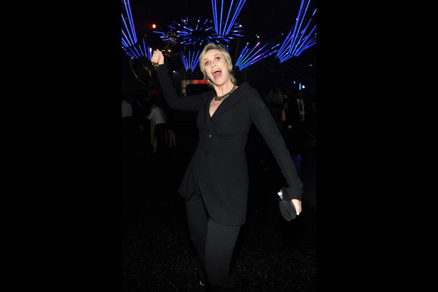 Hollywood Game Night winner Jane Lynch celebrates at the 2014 Creative Arts Emmys ball.