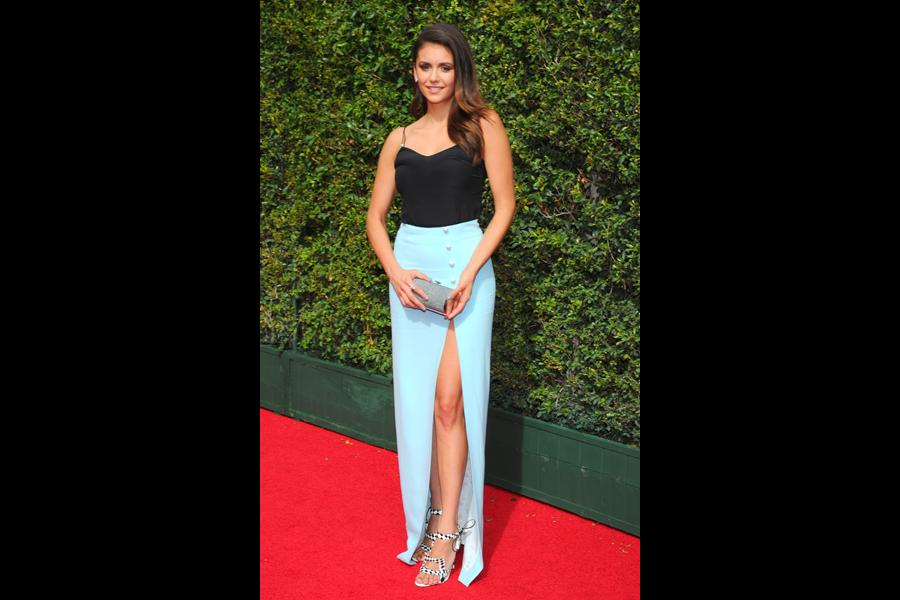 Nina Dobrev arrives on the red carpet at the Creative Arts Emmy Awards 2015.