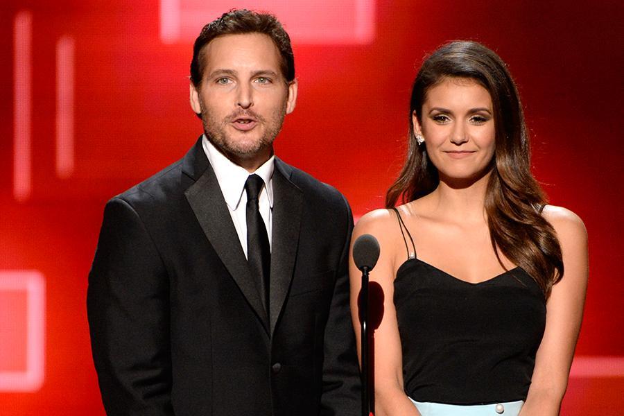 Peter Facinelli and Nina Dobrev presents an award at the Creative Arts Emmy Awards