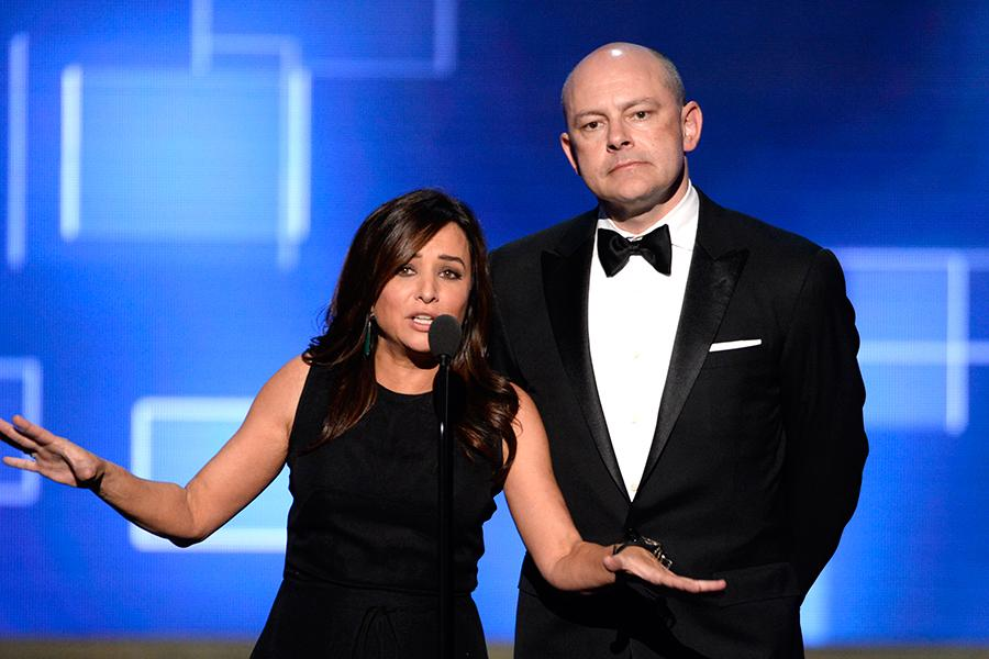 Pamela Adlon, left, and Rob Corddry presents an award at the 2015 Creative Arts Emmy Awards.