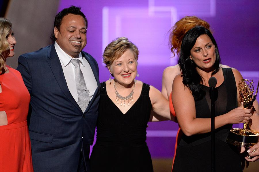The team of Saturday Night Live accepts their award at the 2015 Creative Arts Emmys.