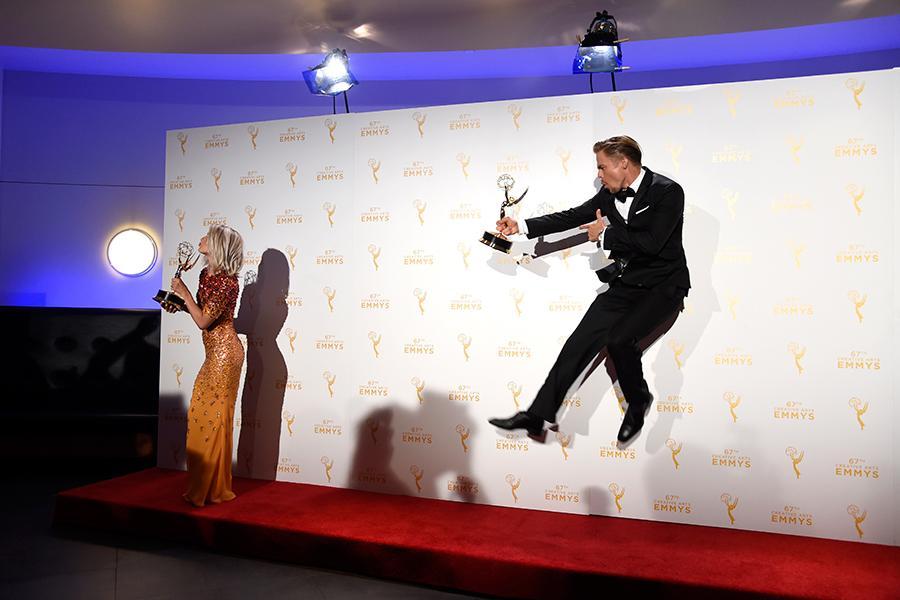 Derek Hough and Julianne Hough backstage at the 2015 Creative Arts Emmy Awards.