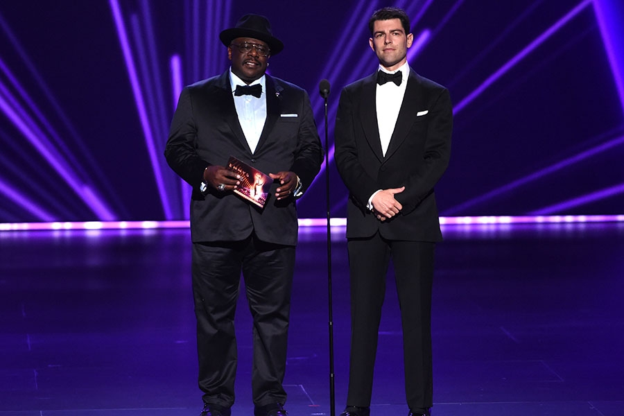 Cedric the Entertainer and Max Greenfield present an award at the 71st Emmy Awards.
