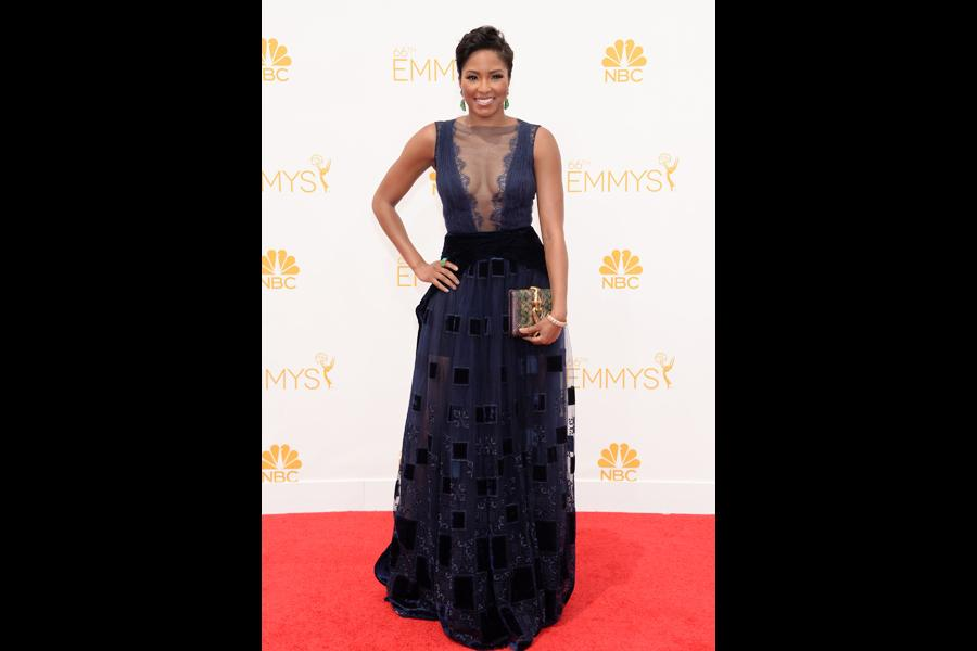 Alicia Quarles of E! News arrives at the 66th Emmys.