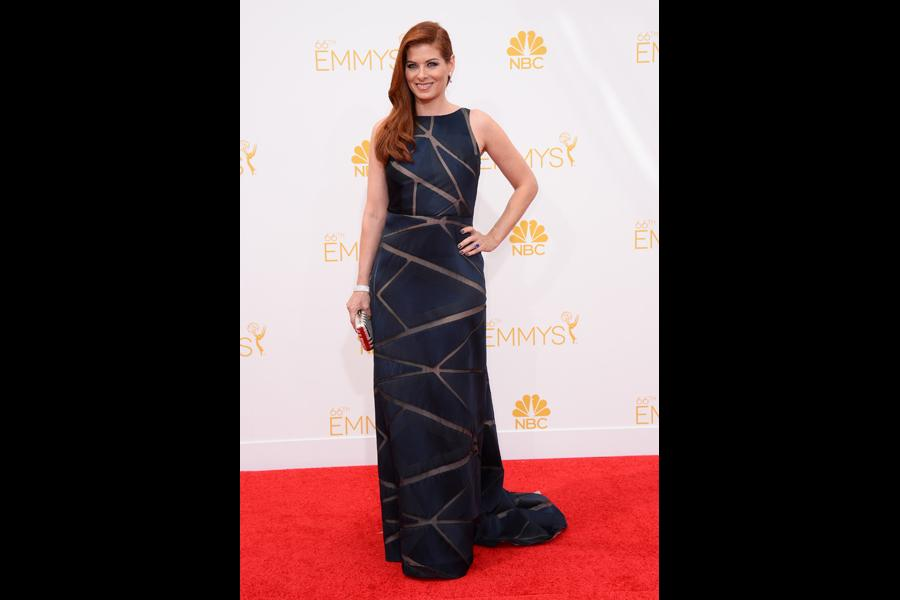 Debra Messing arrives at the 66th Emmys.