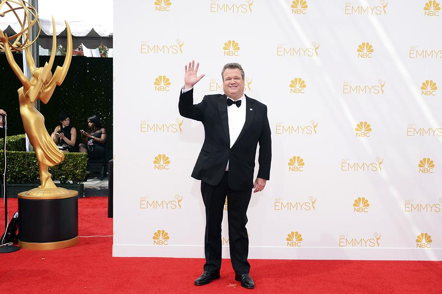 Eric Stonestreet of Modern Family arrives at the 66th Emmy Awards.
