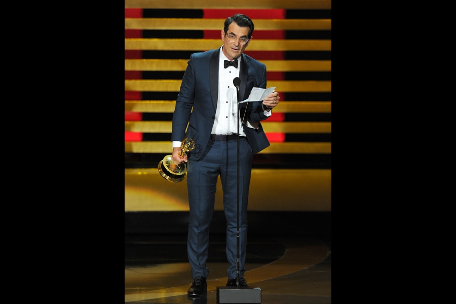 Ty Burrell of Modern Family accepts an award at the 66th Emmy Awards.